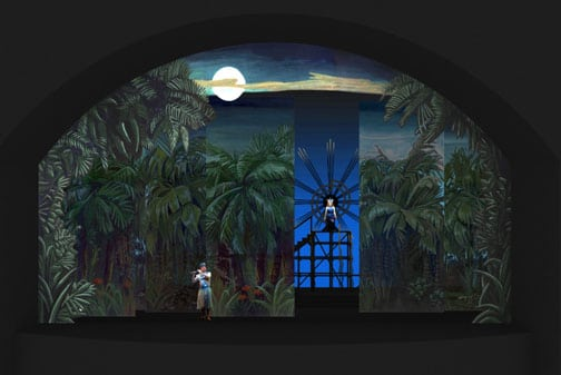 Here, the jungle scrims part to reveal the Queen of the Night standing on an 11 foot platform. Her head is at the center of the central icon of the stage set, a huge 'sun' emblem.